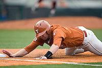 Texas Longhorns designated hitter Kevin Lusson #14 dives back to first base against the Texas A&M Aggies in NCAA Big XII Conference baseball on May 21, 2011 at Disch Falk Field in Austin, Texas. (Photo by Andrew Woolley / Four Seam Images)