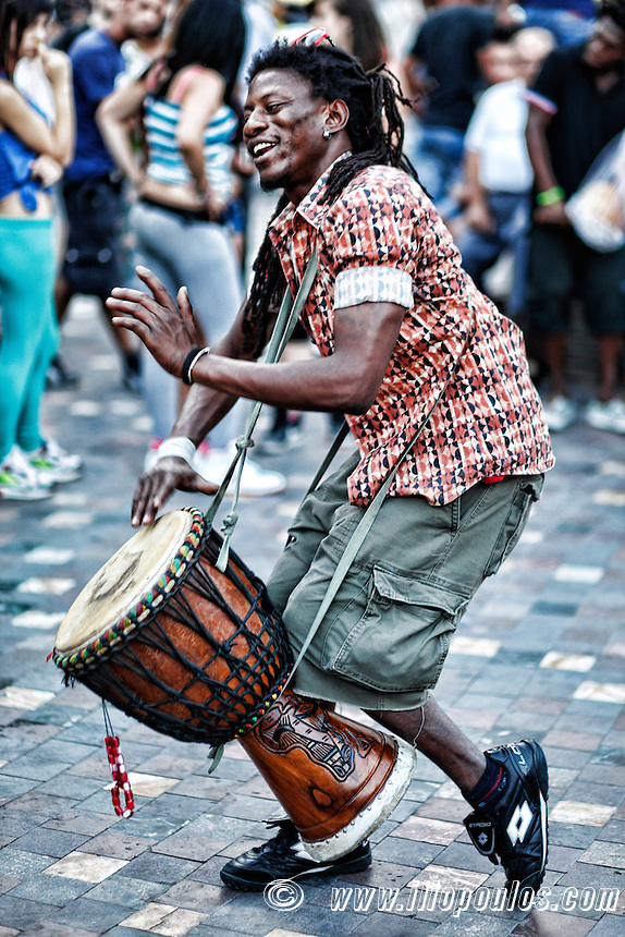 Musician playing percussion in the street of Athens, Greece