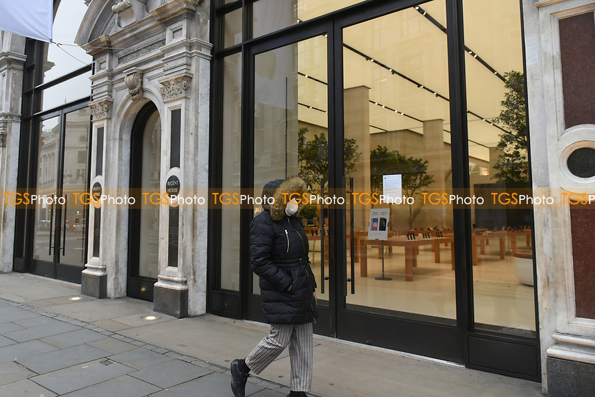 View of the Apple Store in Regent Street. The deserted streets show the severe effects of the COVID-19 epidemic on London on the morning of 19th March 2020