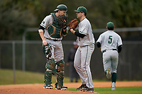Dartmouth Big Green catcher Ben Rice (9) talks with pitcher Austen Michel (35) during a game against the Indiana State Sycamores on February 21, 2020 at North Charlotte Regional Park in Port Charlotte, Florida.  Indiana State defeated Dartmouth 1-0.  (Mike Janes/Four Seam Images)