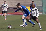 Edinburgh City v Spartans, 11/04/2015. Commonwealth Stadium, Scottish Lowland League. Home team forward Ortega Deniran (white shirt) in first-half action at the Commonwealth Stadium at Meadowbank during the Scottish Lowland League match between Edinburgh City and city rivals Spartans, which was won by the hosts by 2-0. Edinburgh City were the 2014-15 league champions and progressed to a play-off to decide whether there would be a club promoted to the Scottish League for the first time in its history. The Commonwealth Stadium hosted Scottish League matches between 1974-95 when Meadowbank Thistle played there. Photo by Colin McPherson.