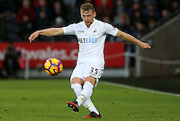 Stephen Kingsley of Swansea City FC crosses the ball into the box during the Premier League match between Swansea City and West Ham United at The Liberty Stadium, Swansea, Wales, UK. Monday 26 December 2016