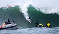 Half Moon Bay, California - January 24, 2014: 2014 Maverick's Invitational Ryan Seelbach making the drop.
