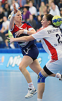 22 OCT 2011 - LONDON, GBR - Britain's Lynn McCafferty (#07 / in blue and red) shoots past Russia's Viktoriya Zhilinskayte (#21 - white) during the Women's 2012 European Handball Championship qualification match between the two countries at the National Sports Centre at Crystal Palace (PHOTO (C) NIGEL FARROW)