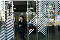 People at the door of Daiwa Bank in Tokyo banking and business district called Otemachi..