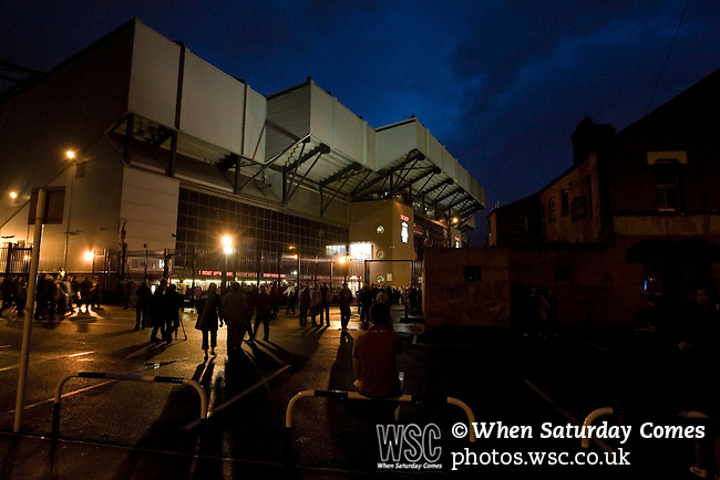 Liverpool 2 Northampton Town 2, 22/09/2010. Anfield, League Cup third round. Fans making their way towards the famous Kop stand at Anfield, illuminated before Liverpool football club's Carling Cup third round tie at home to Northampton Town. The visitors from English League 2 defeated Premier League Liverpool on penalty kicks after a 2-2 draw after extra time in one of the biggest shock results in either clubs histories. Photo by Colin McPherson.
