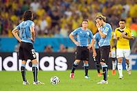 Diego Forlan and Edinson Cavani of Uruguay look dejected