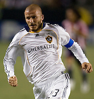 LA Galaxy midfielder and Captain David Beckham (23) chases a ball during the Super Clasico MLS match. The LA Galaxy defeated Chivas USA 5-2 during the SuperClasico at the Home Depot Center Stadium, in Carson, California, Saturday, April 26, 2008.