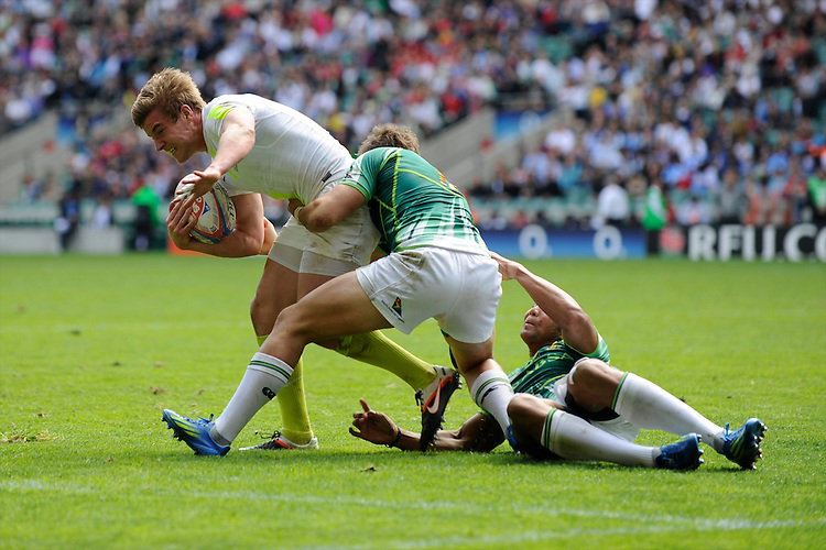 Tom Mitchell of England is tackled during the iRB Marriott London Sevens at Twickenham on Sunday 13th May 2012 (Photo by Rob Munro)