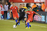 EAST RUTHERFORD, NJ - SEPTEMBER 7: Wil Trapp #6 of the United States battles for the ball with Andres Guardado #18 of Mexico during a game between Mexico and USMNT at MetLife Stadium on September 6, 2019 in East Rutherford, New Jersey.