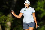 Mirim Lee waves to the crowd after making her putt on the 16th green at the LPGA Championship 2014 Sponsored By Wegmans at Monroe Golf Club in Pittsford, New York on August 17, 2014