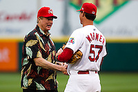 Coach Ron Warner (57) of the Springfield Cardinals shakes hands with Cardinals Legend Steve Carlton prior to a game against the Frisco RoughRiders on April 14, 2011 at Hammons Field in Springfield, Missouri.  Photo By David Welker/Four Seam Images.