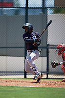 GCL Yankees East D'Vaughn Knowles (4) bats during a Gulf Coast League game against the GCL Phillies West on August 3, 2019 at the Carpenter Complex in Clearwater, Florida.  The GCL Yankees East defeated the GCL Phillies West 4-0, the second game of a doubleheader.  (Mike Janes/Four Seam Images)