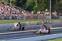 Jun. 1, 2013; Englishtown, NJ, USA: NHRA top fuel dragster driver Doug Kalitta (right) races alongside Khalid Albalooshi during qualifying for the Summer Nationals at Raceway Park. Mandatory Credit: Mark J. Rebilas-