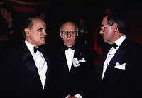 1985 File Photo - Jean Drapeau, Mayor, Montreal (M) with Serge Losique (L) and Roger D.Labdry (R) <br /> <br />  Drapeau was a Canadian lawyer and politician who served as mayor of Montreal from 1954 to 1957 and 1960 to 1986. During his tenure as mayor he was responsible for the construction of the Montreal Metro system and the Place des Arts concert hall, for conceiving Expo 67, for securing the 1976 Summer Olympics, and for helping to bring Major League Baseball to Montreal with the creation of the Montreal Expos.<br /> <br /> Although he is remembered as a visionary, Drapeau's mishandling of the construction of the Olympic Games facilities resulted in massive cost overruns and left the city with a debt of over $1 billion that has taken its citizens over thirty years to fully pay off.