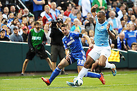 Vincent Kompany (4) Manchester City, shields the ball from Cesar Azpilicueta (28) Chelsea..Manchester City defeated Chelsea 4-3 in an international friendly at Busch Stadium, St Louis, Missouri.