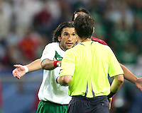 Jose Fonseca (17) of Mexico argues with referee Lubos Michel. Portugal defeated Mexico 2-1 in their FIFA World Cup Group D match at FIFA World Cup Stadium, Gelsenkirchen, Germany, June 21, 2006.