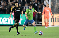 LOS ANGELES, CA - OCTOBER 29: Nicolas Lodeiro #7 of Seattle Sounders FC moves with the ball during a game between Seattle Sounders FC and Los Angeles FC at Banc of California Stadium on October 29, 2019 in Los Angeles, California.