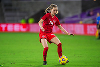 ORLANDO, FL - FEBRUARY 21: Gabrielle Carli #14 of the CANWNT passes the ball during a game between Argentina and Canada at Exploria Stadium on February 21, 2021 in Orlando, Florida.