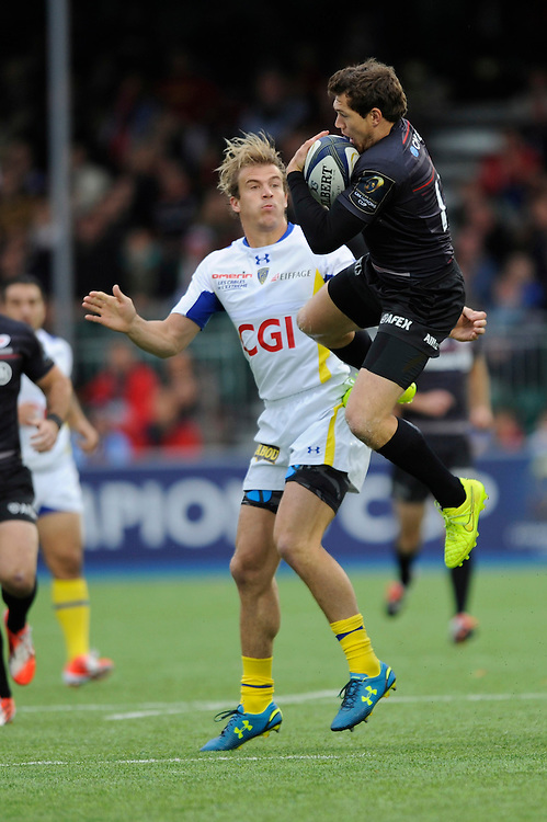 Alex Goode of Saracens secures the high ball as Aurélien Rougerie of ASM Clermont Auvergne challenges during the European Rugby Champions Cup  Round 1 match between Saracens and ASM Clermont Auvergne at the Twickenham Stoop on Saturday 18th October 2014 (Photo by Rob Munro)