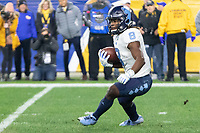 North Carolina running back Michael Carter (8) returns a kick. The Pitt Panthers defeated the North Carolina Tarheels 34-27 in overtime in the football game on November 14, 2019 at Heinz Field, Pittsburgh, Pennsylvania.