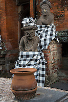 Bali, Indonesia.  Hindu  Guardian Statues  Wearing Saput Poleng, the black and white cloth symbolizing the dual nature of the universe.  Inside the Kerta Gosa Compound,  Klungkung, Semarapura.