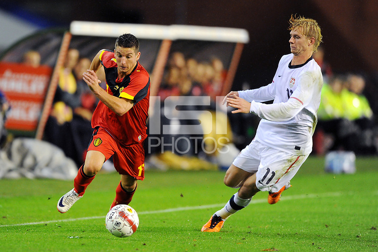 USA's Brek Shea (r) and Belgium's Dries Mertens fight for the ball during the friendly match Belgium vs USA at King Baudoin stadium in Brussels, Belgium on September 06th, 2011.