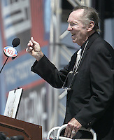 Al Davis, owner of the Oakland Raiders, introduces John Madden during the Pro Football Hall of Fame induction ceremony Saturday, Aug. 5, 2006, in Canton, Ohio.<br />