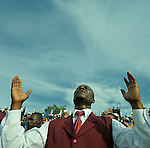 Just before the one-year anniversary of the January 2010 earthquake that ravaged Port-au-Prince, Haiti, this man joined with thousands of others in the capital's soccer stadium for a religious gathering.