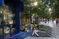 BULGARIEN, 09.2009.Sliven.Diese zentralbulgarische Industriestadt ist einer der wichtigsten Herkunftsorte fuer in Westeuropa arbeitende Prostituierte:.Frauen der Stadt - in der herausgeputzten Fussgaengerzone, der einzigen Flaniermeile. Vorne Kiosk mit Nationalfarben..This central-bulgarian industrial town is one of the main origins of prostitutes for Western Europe, especially Belgium and Holland:.Women of the town - in the pedestrian street, the only place to stroll. To the left a kiosk with national colours..© Martin Fejer/EST&OST