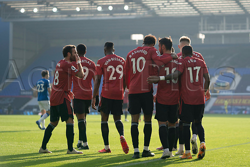 7th November 2020; Liverpool, England; - Manchester Uniteds Bruno Fernandes 3rd R celebrates with teammates after scoring his second goal during the Premier League match between Everton and Manchester United at Goodison Park Stadium