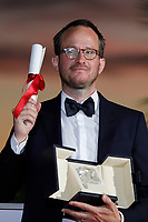 CANNES, FRANCE - JULY 17: Juho Kuosmanen poses with the 'Grand Prix' Ex-Aequo for 'Hytti nro 6' during the 74th annual Cannes Film Festival on July 17, 2021 in Cannes, France. (<br /> CAP/GOL<br /> ©GOL/Capital Pictures