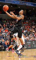 Dec. 22, 2010; Charlottesville, VA, USA; Seattle Redhawks guard Cervante Burrell (5) shoots the ball during the game against the Virginia Cavaliers at the John Paul Jones Arena. Mandatory Credit: Andrew Shurtleff
