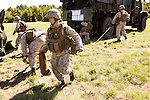 October 22, 2014. Camp LeJeune, North Carolina.<br />  Cpl. Angelique Preston, age 21, of artillery Battery A of the Ground Combat Element Integrated Task Force, runs with a sand bag as her unit sets up one of their M777 howitzers.<br />  The Ground Combat Element Integrated Task Force is a battalion level unit created in an effort to assess Marines in a series of physical and medical tests to establish baseline standards as the Corps analyze the best way to possibly integrate female Marines into combat arms occupational specialities, such as infantry personnel, for which they were previously not eligible. The unit will be comprised of approx. 650 Marines in total, with about 400 of those being volunteers, both male and female. <br />  Jeremy M. Lange for the Wall Street Journal<br /> COED