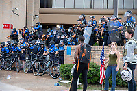 AUSTIN, TEXAS - MAY 30, Police officers close ranks and fire on the crowd of Black Lives Matter protesters with less lethal rounds at the Austin Police Department Headquarters on May 30, 2020 in Austin, Texas<br />