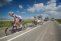 Jonas Van Genechten (BEL) & Tim Wellens (BEL) escorting André Greipel (DEU) back into the peloton<br /> <br /> Eneco Tour 2013<br /> stage 3: Oosterhout - Brouwersdam (187km)