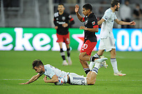 WASHINGTON, DC - MAY 13: Alvaro Medran #10 of Chicago Fire FC battles for the ball with Edison Flores #10 of D.C. United during a game between Chicago Fire FC and D.C. United at Audi FIeld on May 13, 2021 in Washington, DC.