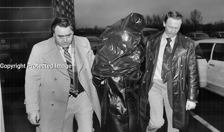Faces masked by garbage bags; three suspects in the pistol-whipping; $148;716 robbery of Canada Trust in Scarborough arrive at 41 division police station to take part in a line-up.<br /> <br /> Photo : Boris Spremo - Toronto Star archives - AQP