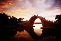 A stone bridge near South Gate at the Summer Palace. The Summer Palace, a palace 15km from Beijing, is mainly dominated by Longevity Hill (60 meters high) and Kunming Lake. It covers an expanse of 2.9 square kilometers, three quarters of which is water.