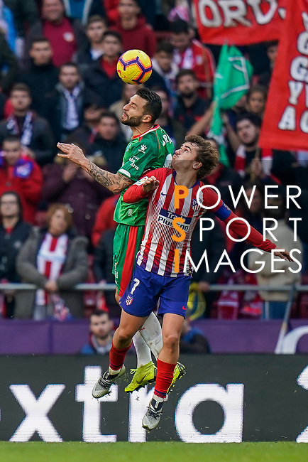 Borja Gonzalez Tomas of Deportivo Alaves (L) in action against Antoine Griezmann of Atletico de Madrid during the La Liga 2018-19 match between Atletico de Madrid and Deportivo Alaves at Wanda Metropolitano on December 08 2018 in Madrid, Spain. Photo by Diego Souto / Power Sport Images