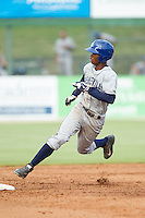 Raimel Tapia (15) of the Asheville Tourists rounds second base during the game against the Kannapolis Intimidators at CMC-NorthEast Stadium on July 13, 2014 in Kannapolis, North Carolina.  The Tourists defeated the Intimidators 8-2.  (Brian Westerholt/Four Seam Images)