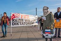 """Menschenrechtsaktion der Gesellschaft fuer bedrohte Voelker (GfbV) vor dem Laenderspiel Deutschland-Brasilien. Unter dem Motto """"FIFA: Keine Spiele fuer Diktatoren –Menschenrechte staerker beruecksichtigen!"""" protestierte die GfbV am Dienstag den 27. Maerz 2018 vor dem Berliner Olympiastadion gegen die Vergabe von Weltmeisterschaften an Diktaturen wie Russland oder Katar. Die Organisation fordert """"dass bei der Vergabe der Turniere Menschenrechte zukuenftig eine groessere Rolle spielen muessen. Wer Meinungs- und Pressefreiheit mit Fuessen tritt, willkuerlich verhaften und foltern laesst und beim Bau von Stadien massiv Menschenrechte verletzt, disqualifiziert sich selbst als Austragungsort fuer WM-Turniere.""""<br /> Im Bild: """"WM zu verkaufen"""" - Eine Teilnehmerin der Aktion habt sich als Russischer Praesident Putin verkleidet.<br /> 27.1.2018, Berlin<br /> Copyright: Christian-Ditsch.de<br /> [Inhaltsveraendernde Manipulation des Fotos nur nach ausdruecklicher Genehmigung des Fotografen. Vereinbarungen ueber Abtretung von Persoenlichkeitsrechten/Model Release der abgebildeten Person/Personen liegen nicht vor. NO MODEL RELEASE! Nur fuer Redaktionelle Zwecke. Don't publish without copyright Christian-Ditsch.de, Veroeffentlichung nur mit Fotografennennung, sowie gegen Honorar, MwSt. und Beleg. Konto: I N G - D i B a, IBAN DE58500105175400192269, BIC INGDDEFFXXX, Kontakt: post@christian-ditsch.de<br /> Bei der Bearbeitung der Dateiinformationen darf die Urheberkennzeichnung in den EXIF- und  IPTC-Daten nicht entfernt werden, diese sind in digitalen Medien nach §95c UrhG rechtlich geschuetzt. Der Urhebervermerk wird gemaess §13 UrhG verlangt.]"""