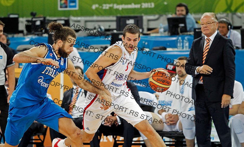 """Luigi Datome of Italy (L) and Nemanja Bjelica of Serbia (R) in action during European basketball championship """"Eurobasket 2013""""  basketball game for 7th place between Serbia and Italy in Stozice Arena in Ljubljana, Slovenia, on September 21. 2013. (credit: Pedja Milosavljevic  / thepedja@gmail.com / +381641260959)"""