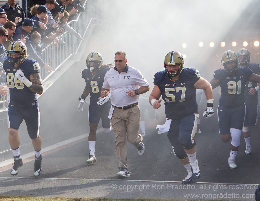 Pitt head coach Pat Narduzzi takes the field along with tight end JP Holtz (86), Lafayette Pitts (6), Artie Rowell (57) and Darryl Render (91). The Miami Hurricanes football team defeated the Pitt Panthers 29-24 on  Friday, November 27, 2015 at Heinz Field, Pittsburgh, Pennsylvania.