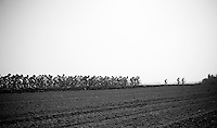 a few riders riding ahead of the peloton (without actually breaking away)<br /> <br /> Amstel Gold Race 2014