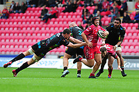 Taylor Davies of Scarlets evades the tackle of Ian Nagle of Zebre Rugby during the Guinness Pro14 Round 02 match between the Scarlets and Zebre Rugby at the Parc Y Scarlets Stadium in Llanelli, Wales, UK. Saturday 12 October 2019