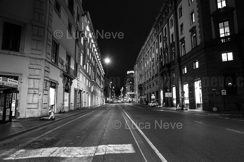 """Via del Tritone.<br /> <br /> Rome, 23/10/2020. Documenting the """"curfew"""" (coprifuoco) imposed from Friday night in Rome and its surrounding Lazio Region. The local authorities tightened rules and restrictions due to a spike in the Covid-19 / Coronavirus cases. 23 October bulletins sees 19.143 new cases, 91 people died, 182.032 tests made. Today, the President of Lazio Region, Nicola Zingaretti (Leader of the Democratic Party, PD, party member of the Italian Coalition Government), imposed the night curfew, from midnight to 5AM, for 30 days (1.). A new self-certification (autocertificazione, downloadable from here 1.) is needed to leave home which is allowed only for urgent reasons, mainly work and health. Furthermore, the Mayor of Rome, Virginia Raggi, implemented """"no-go zones"""" restrictions from 9PM in some of the areas and squares of the Eternal City famous for the nightlife, including Campo de' Fiori, Via del Pigneto, Piazza Trilussa in Trastevere district and Piazza Madonna de' Monti.<br /> <br /> Footnotes & Links:<br /> 1. http://www.regione.lazio.it/binary/rl_main/tbl_news/ordinanza_regione_lazio_intesa_Ministro_salute__mod_accettate_rev1__ore_24_1_signed.pdf<br /> <br /> March 2020, Coronavirus lockdown in Rome:<br /> - 12.03.2020 - Rome's Lockdown for the Outbreak of the Coronavirus In Italy - SARS-CoV-2 - COVID-19: https://lucaneve.photoshelter.com/gallery/12-03-2020-Romes-Lockdown-for-the-Outbreak-of-the-Coronavirus-In-Italy-SARS-CoV-2-COVID-19/G0000jGtenBegsts/<br /> - 07-23.03.2020 - Villaggio Olimpico Ai Tempi del COVID-19 - Rome's Olympic Village Under Lockdown: https://lucaneve.photoshelter.com/gallery/07-23-03-2020-Villaggio-Olimpico-Ai-Tempi-del-COVID-19-Romes-Olympic-Village-Under-Lockdown/G0000D2L9l0ibXZI/"""