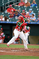 """Palm Beach Cardinals catcher Jose Godoy (27) at bat during a game against the Charlotte Stone Crabs on July 22, 2017 at Roger Dean Stadium in Palm Beach, Florida.  The Cardinals wore special """"Ugly Sweater"""" jerseys for Christmas in July.  Charlotte defeated Palm Beach 5-2.  (Mike Janes/Four Seam Images)"""