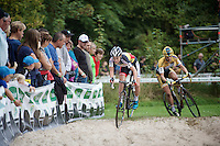 Sanne Cant (BEL/Ciclismo Mundial) hitting the sand first, Ellen Van Loy (BEL/Telenet-Fidea) following closely<br /> <br /> GP Neerpelt 2014