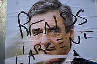 France. Ile de France. Paris. Partially torn campaign poster of French presidential election candidate François Fillon for the right wing Les Républicains (LR). A graffiti with the written words: Give back the money. 21.04.17  © 2017 Didier Ruef